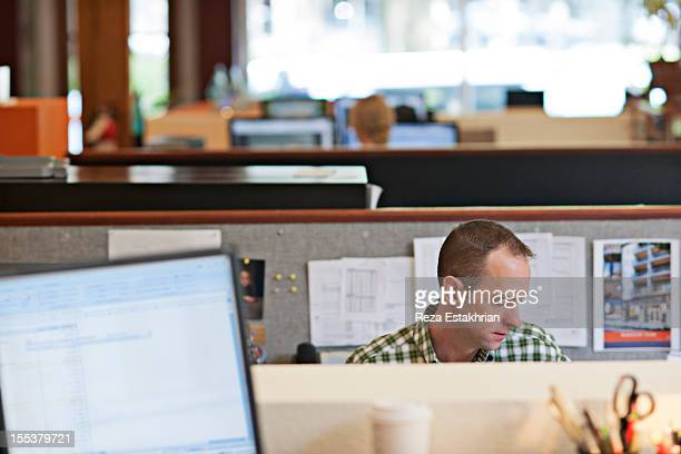 Man in his office cubicle