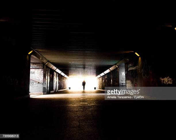 Man In Illuminated Tunnel