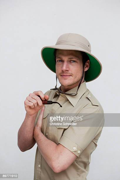 man in jungle outfit looking at viewer