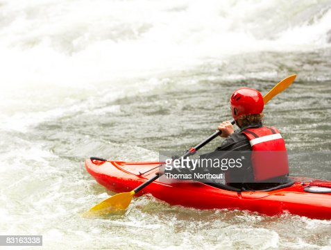 Man in kayak about to enter rapids : Stock Photo
