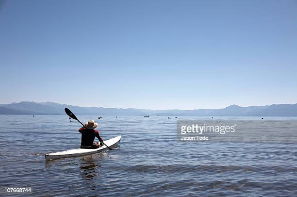 man in kayak on lake