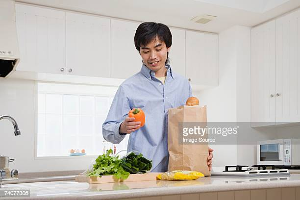 Man in kitchen with groceries