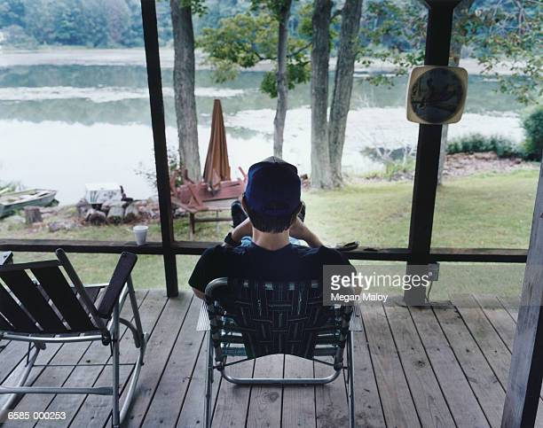 Man in Lounge Chair on Porch