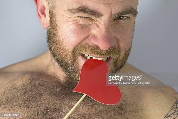 Man in love bites a heart