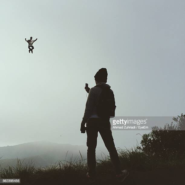 Man In Mid-Air Falling Performing Stunt