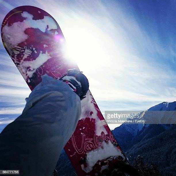 Man In Mid-Air On Snowboard