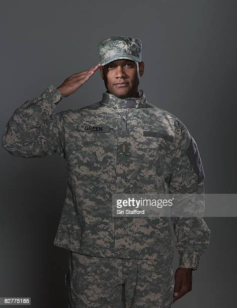 man in military uniform, saluting