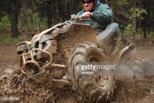 Man in mud on quad