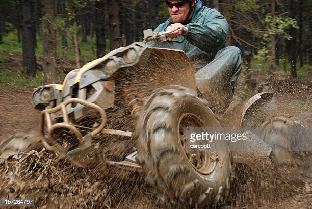 Man in mud on quad