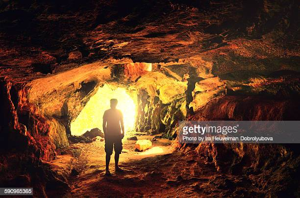 Man in natural cave, Curacao