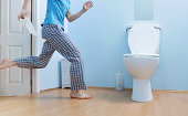Man in night clothes running to toilet