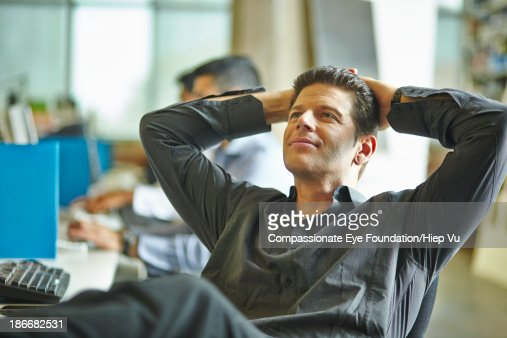 Man in office leaning back in chair