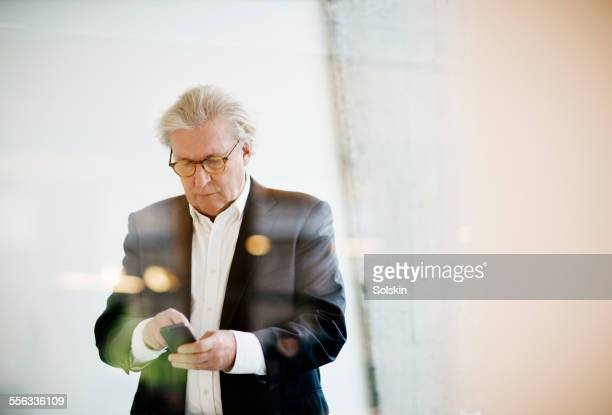Man in office using smartphone