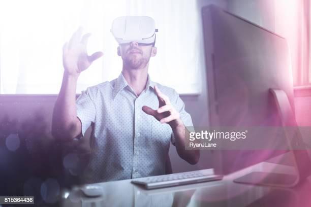 Man in Office Wearing VR Headset