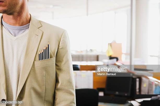 Man in office with pencils of varying lengths in pocket, close-up
