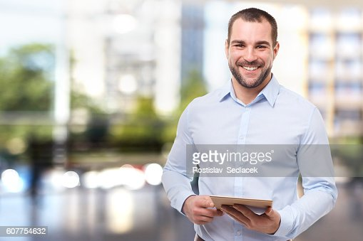 Man in office with tablet computer : Stock Photo