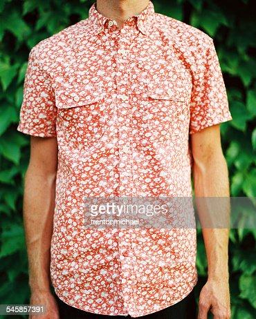 Man in orange shirt