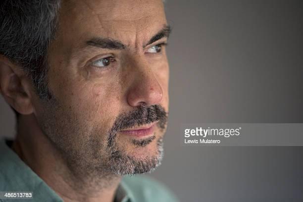 Man in pensive, thoughtful, sad, yet hopeful mood