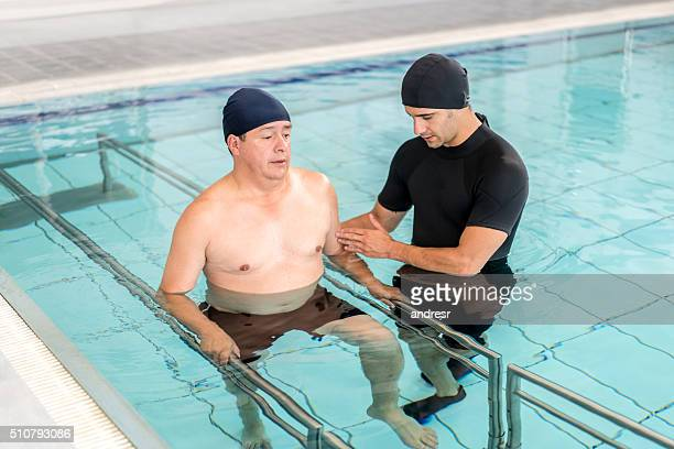Man in physical therapy in the water