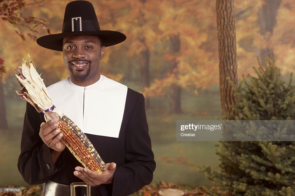 Man in pilgrim costume holding corn  Stock Photo  sc 1 st  Thinkstock & Man In Pilgrim Costume Holding Corn Stock Photo | Thinkstock