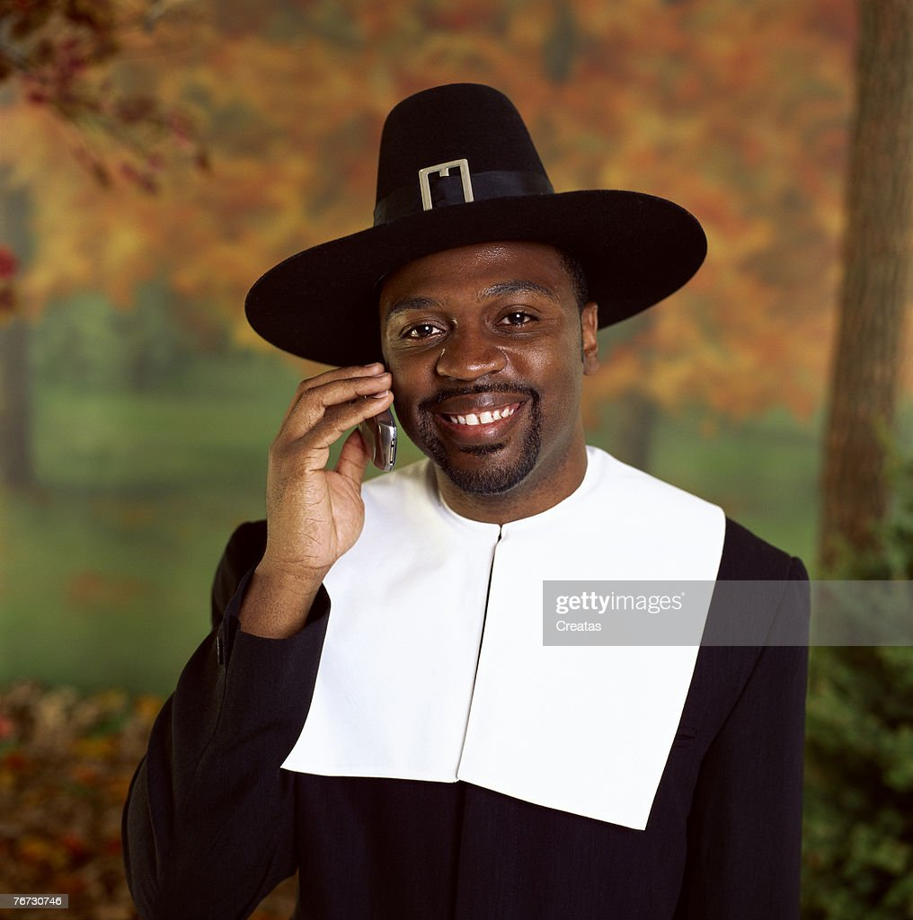 Man in pilgrim costume on cell phone  Stock Photo  sc 1 th 225 & Man In Pilgrim Costume On Cell Phone Stock Photo | Thinkstock