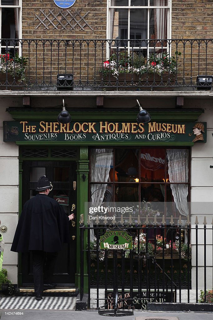 A man in police costume enters the former home of the fictional Character Sherlock Holmes on April 5, 2012 in London, England. 221B Baker Street is the London address of the fictional detective Sherlock Holmes, which was created by author Sir Arthur Conan Doyle.