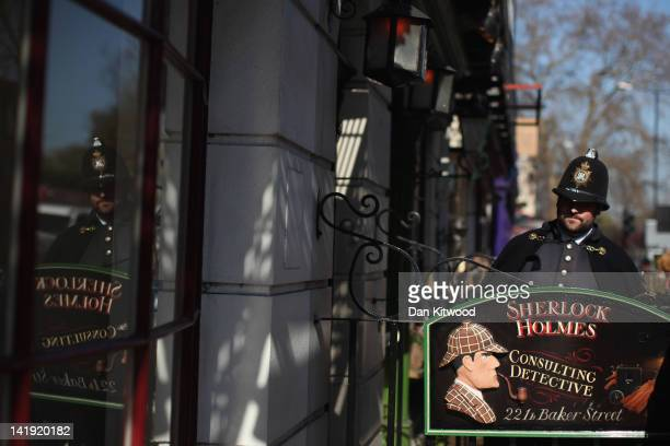 A man in police costume stands outside the former home of the fictional Character Sherlock Holmes on March 26 2012 in London England 221B Baker...