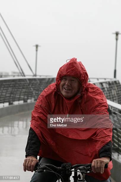 Man in raincoat cycling