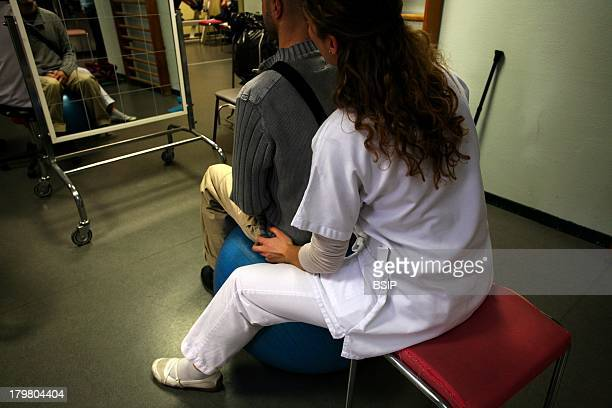 Man In Rehabilitation SaintJean hospital in France Physiotherapy session for a neurological rehabilitation after a CVA cerebrovascular accident...