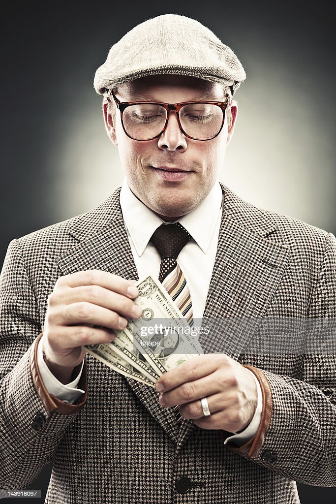 Man in retro suit counting money : Stock Photo