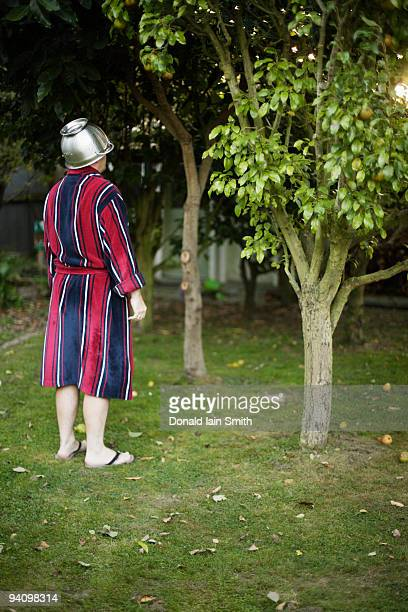 Man in robe with collander