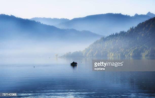 Man in rowing boat on lake Aegeri, Zug, Switzerland