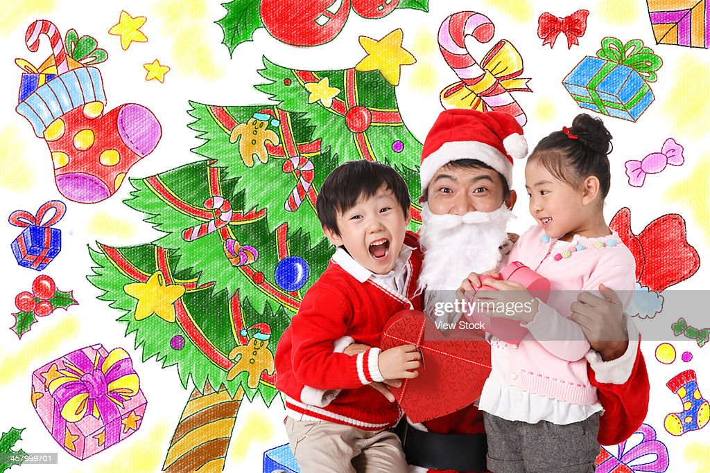 Man in Santa Claus with boy and girl