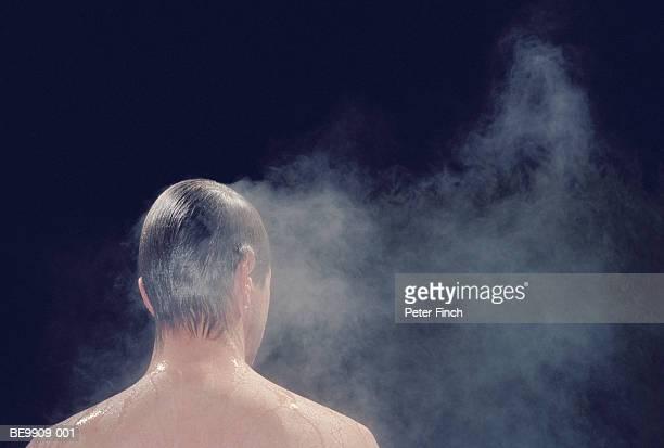 Man in sauna, rear view