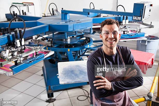 Man in screen printing business