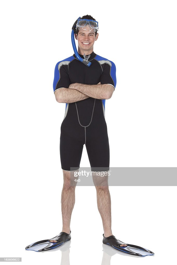 Man in scuba gear standing with arms crossed