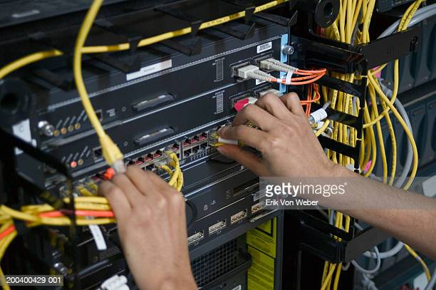 Man in sever room working with cables