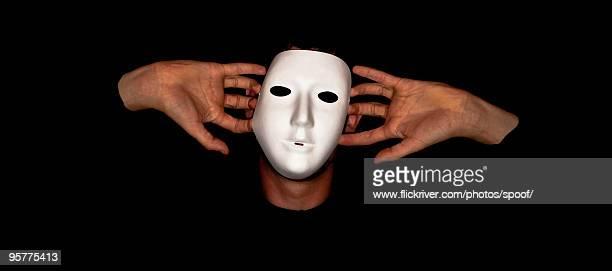 Man in silver venetian mask