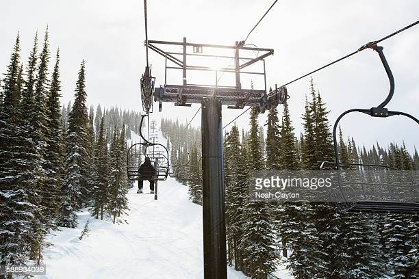 Man in ski lift, rear view