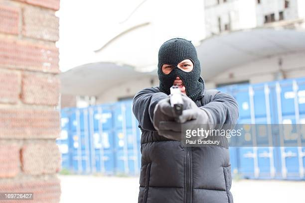 Man in ski mask holding gun