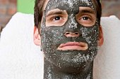Man in skincare face mask with salt