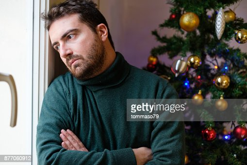 Man in solitude feeling bad during christmas day : Stock Photo