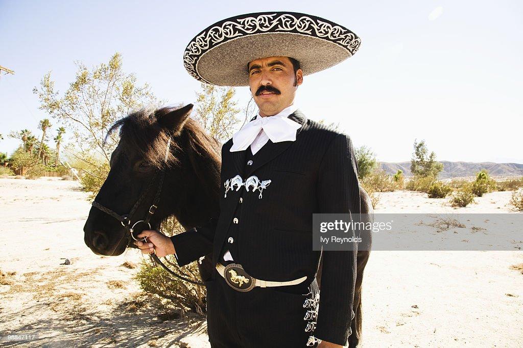 Man in sombrero with horse