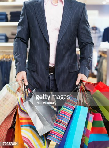 Man in store with shopping bags : Stock Photo