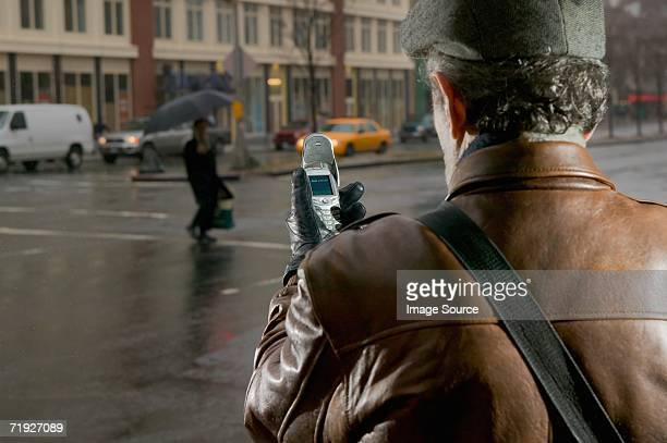 Man in street with cell phone