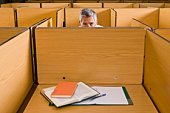 Man in study cubicle