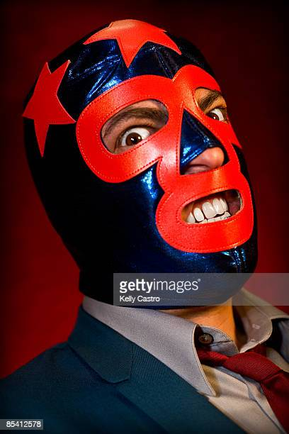 Man in suit and mexican wrestling mask