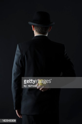 Man In Suit Back View Holding An Apple Stock Photo | Getty ...