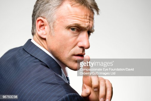 Man in suit gesturing with his hand : Stock Photo