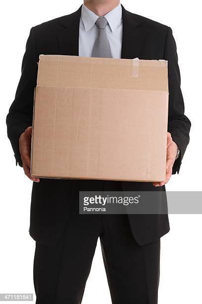 Man in Suit Holding Box